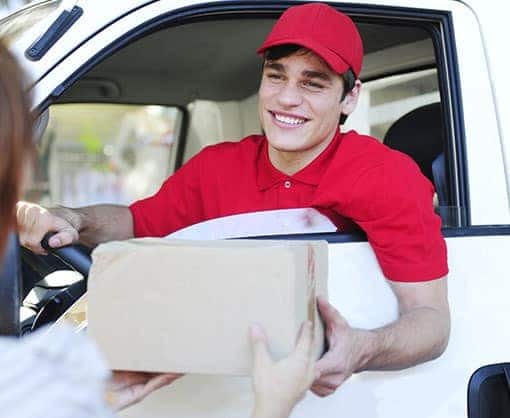 Delivery man giving an item to the client