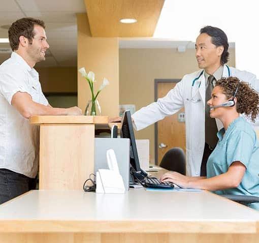 Medical staff having conversation on patient