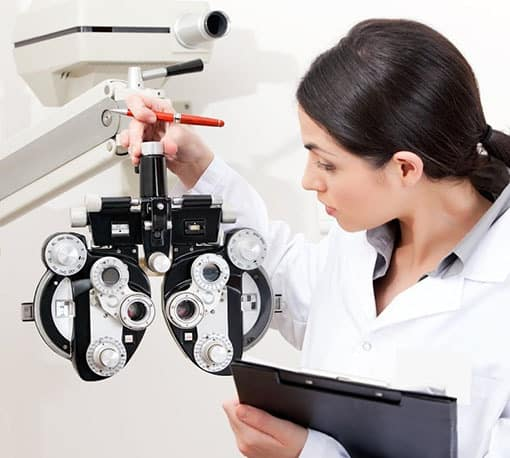 Medical staff checking on optometric machine