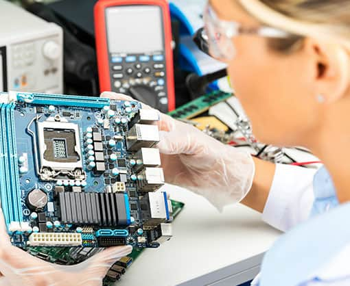 Technical staff working on a motherboard