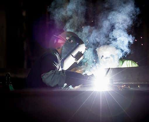 Two welders working