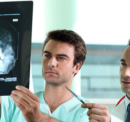 Doctors discussing X-ray result