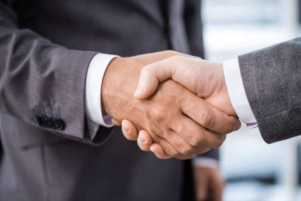 Shaking hands while applicant getting hired from job