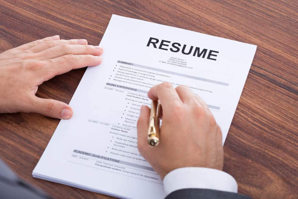 Close up of man reviewing a resume