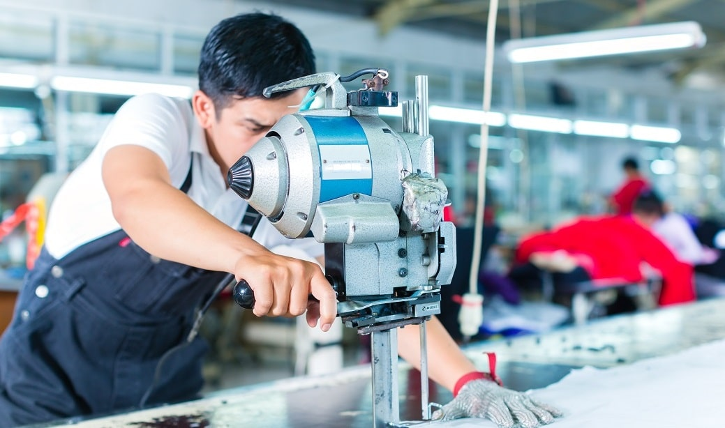 Indonesian,Worker,Using,A,Cutter,-,A,Large,Machine,For