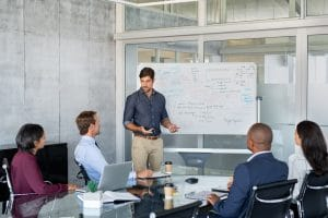 Company executive presenting new management strategy to team