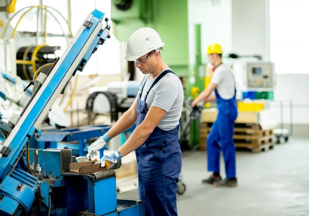 Worker,With,Goggles,And,Helmet,On,The,Machine